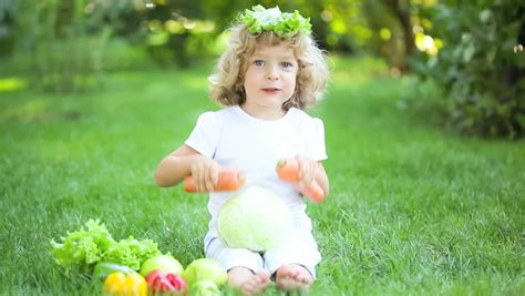 naturist fruits kids happy child playing with fruits and vegetables in spring