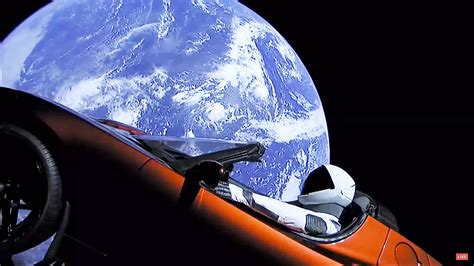 elon musk space elon musk launches tesla into orbit on spacex s falcon heavy