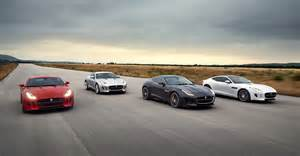 exotic cars lined up jaguar f type coupe r