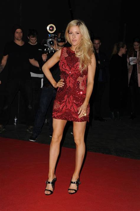 Minidress Elie ellie goulding swaps plunging sheer gown for