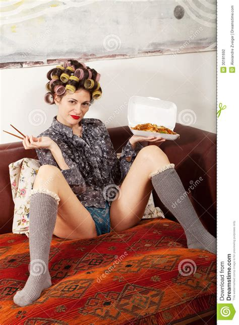 legs for a couch girl eating spaghetti on the couch stock photo image