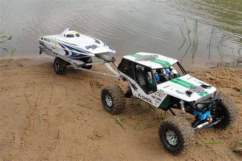 rc truck pulling boat rc scale axial wraith pulling and launch rc boat wildcat