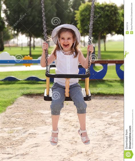 age for baby swing at park laughing child on swing in summer park stock image image