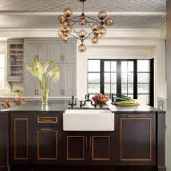 gold black kitchen thick white marble countertops contemporary kitchen