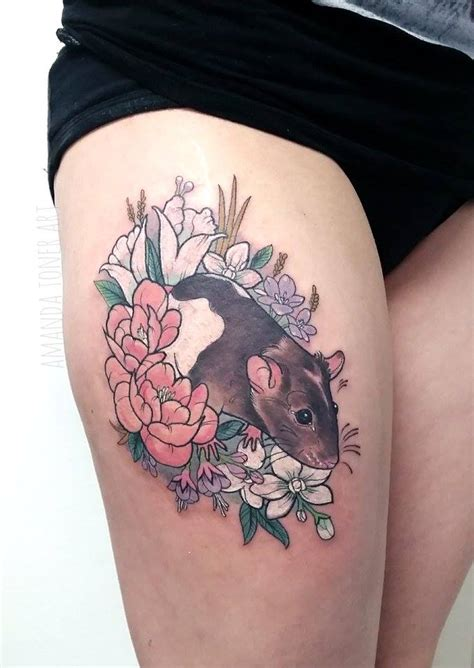 rat in flowers tattoo on right thigh by amanda toner art