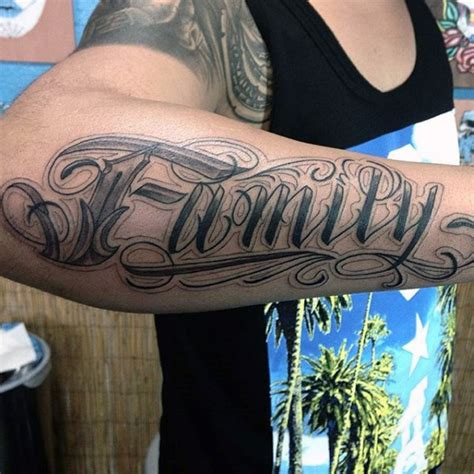 family tattoo on bicep incredible design lettering family tattoo on arm
