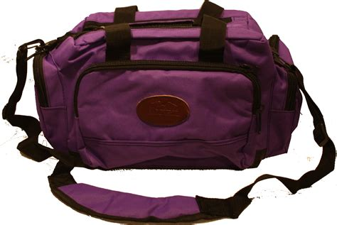 purple deluxe range bag with purple muffs glasses