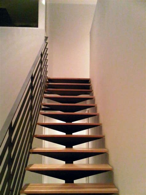 open steel staircase floating hickory treads blackened steel railing