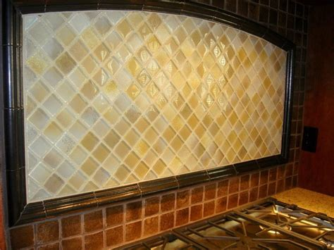 italian tile on the backsplash rubbed bronze