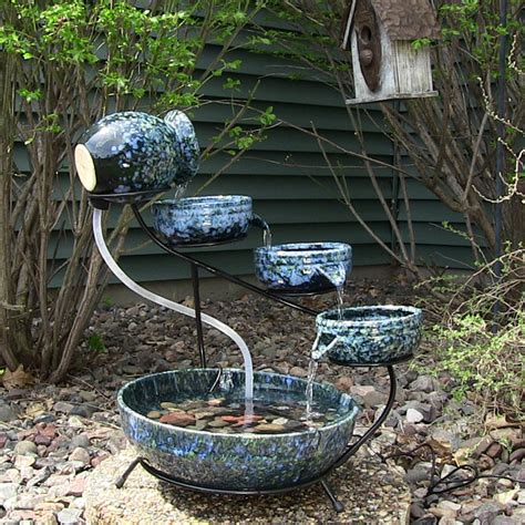 Decorative Outdoor Solar Water Fountains by Outdoor Classics Decorative Blue Ceramic Cascade Solar