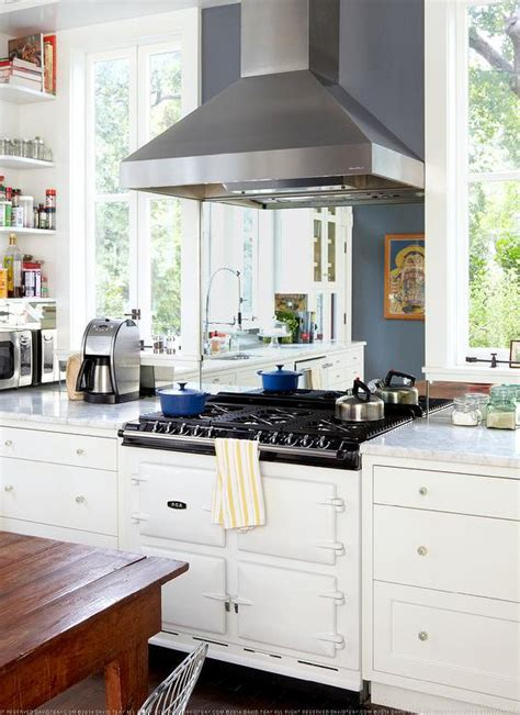 Shiny White Kitchen Cabinets stove next to cooktop design ideas
