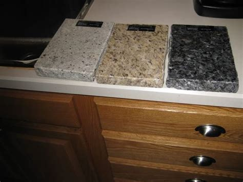 light granite countertops with dark cabinets golden oak kitchen cabinets with black countertops