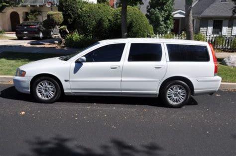 buy  white  volvo   wagon  door   miles  row rear facing seats