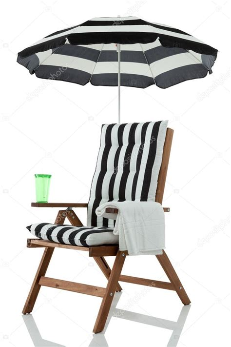 chair with umbrella towel and drink stock photo