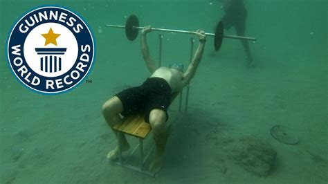 bench world record guinness world record most bench presses underwater