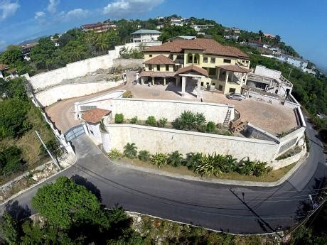Holness stoutly defends his ?big house?  Every poor man