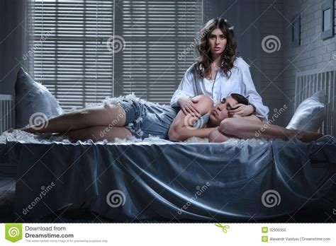 the love bed portrait of a young couple stock image image of mess