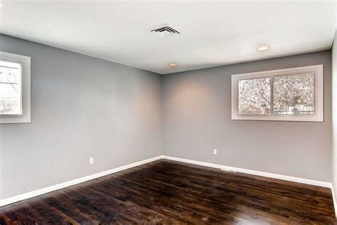 gray walls white baseboards dark hardwood floors