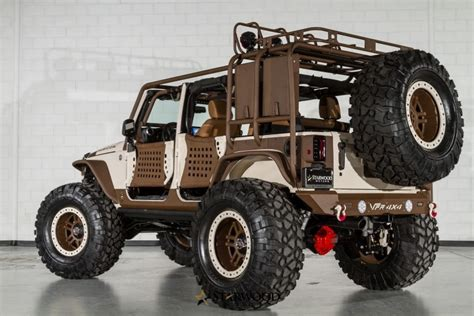 starwood motors jeep white this starwood motors sema jeep is king of the mountain