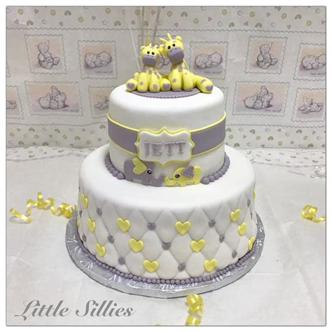 Giraffe Baby Shower Theme by A Yellow And Grey Giraffe And Elephant Themed Baby Shower