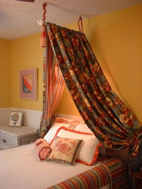 curtain that hangs over bed canopy hang a curtain rod from the ceiling and then