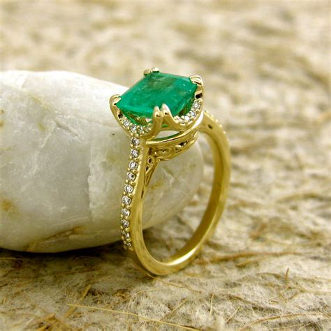 cushion cut emerald engagement ring in 14k yellow gold with
