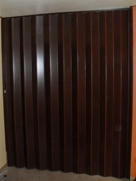 Wood Accordion Doors by Pvc Accordion Door Vs Wooden Door Quezon City