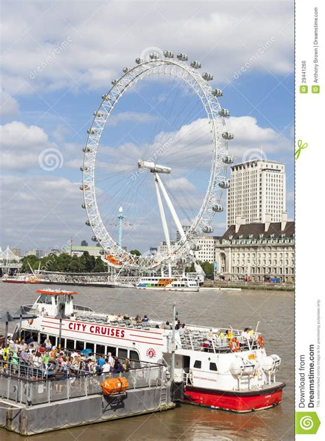 thames river boat cruise and london eye city cruise boat and london eye on river thames editorial