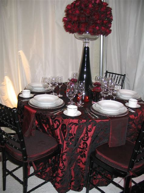 I love the black lace overlay on top of the red tablecloth