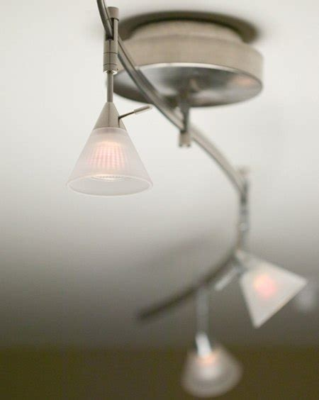 can you add a light kit to any ceiling fan how to light a wall with recessed and track lighting