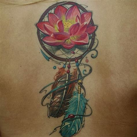 dreamcatcher tattoo with lily a tattoo of a dream catcher with a water lily in its snare