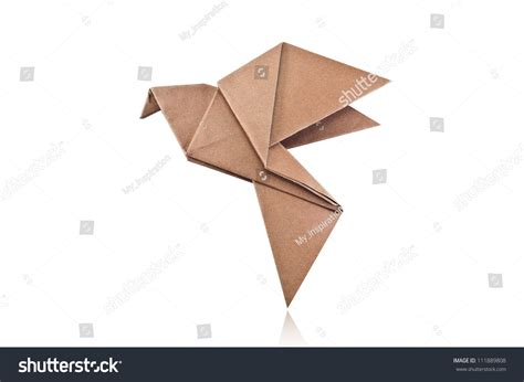 Origami White Paper - origami brown paper bird on white background stock photo