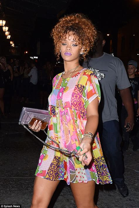 rihanna parades  legs  pink heels  short party