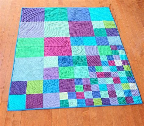 Square Patchwork Quilt - modern patchwork quilt scattering squares
