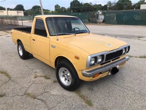 yellow toyota truck 1973 toyota hilux yellow vintage minitruck up clean