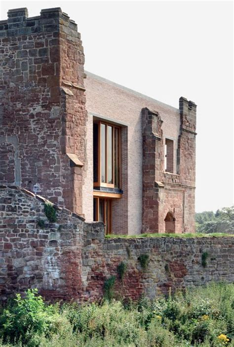 modern castle contemporary house inserted into crumbling castle ruins