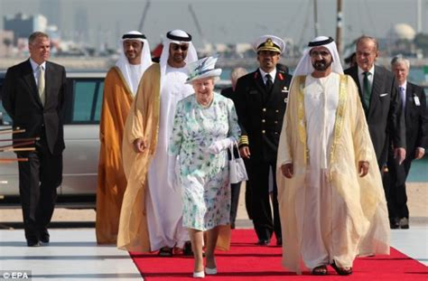 emirates queen queen is shoeless and dons beekeeper hat on abu dhabi