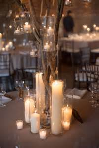 wedding centerpieces with branches and lights the candles and the stark feel of it wedding decor