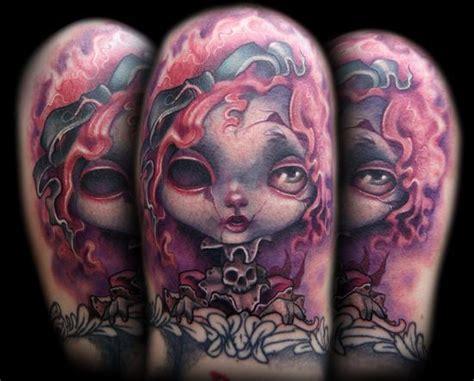 creepy doll tattoo by kelly doty tattoos