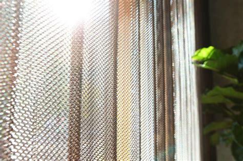 sunlight through wire mesh cascade coil curtains wire