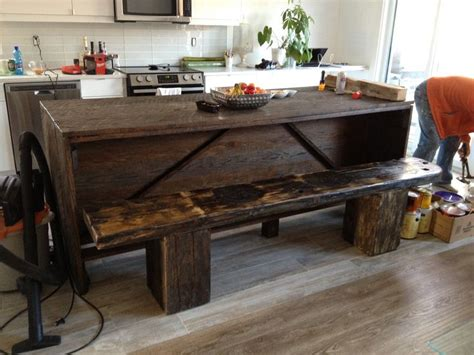 9 foot kitchen island made of oak with cobblers bench