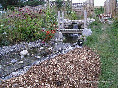 how to build a backyard stream cascading garden stream build a cascading stream on sloped yard