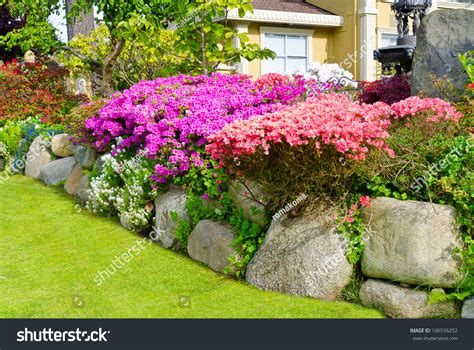 landscape design in front of house flowers and stones in front of the house front yard landscape design stock photo