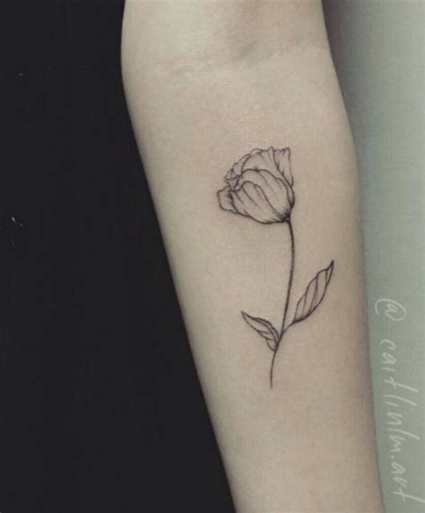 tulips tattoo minimalistic tulip lvlly tattooes