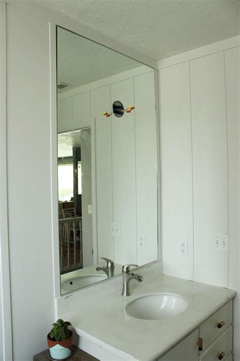 how to hang a bathroom mirror with a frame how to professionally install a bathroom mirror