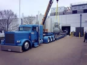 Slammed flat peterbilt triaxle with 2 axle rgn hot rod trucks