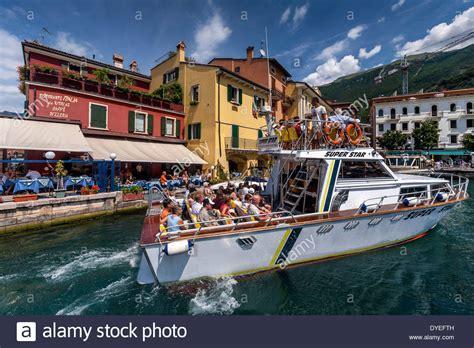 boat trip lake garda tourists taking a boat trip malcesine lake garda italy