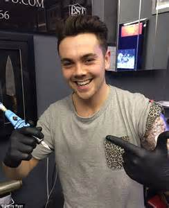 x factor s ray quinn signs autograph on leg of celebrity