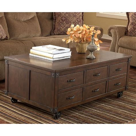 Kordell Cocktail Table With Storage Signature Design By Coffee Table Dvd Storage