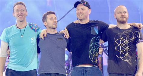 coldplay back to the star chris martin brings michael j fox on stage for back to